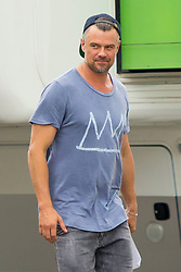 EXCLUSIVE: FIRST ONSET PHOTOS Megan Fox and Josh Duhamel are seen on set as filming starts for their new movie 'Think Like A Dog' with scripts in their hands. The two hollywood stars were joined by child actor, Gabriel Bateman. The film is about a 12-year-old tech prodigy whose science experiment goes awry and he forges a telepathic connection with his best friend, his dog. Megan could be seen wearing yoga pants, sneakers and with a hoodie over her arms while wearing a grey t-shirt. Josh could be seen wearing a 'Basquiat' t-shirt, 'Ascot' cap and grey jeans with leather boots. 05 May 2018 Pictured: Josh Duhamel. Photo credit: MEGA TheMegaAgency.com +1 888 505 6342
