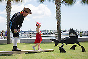 A young girl walks the plank during the Charleston Pirate Festival at the Maritime Center August 11, 2013 in Charleston, SC. Charleston has a deep history with pirates and was once the haunt of notorious pirates Blackbeard, Anne Bonny and Mary Read.
