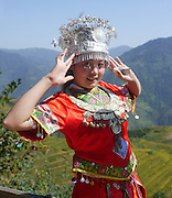 China, Guangxi Province, Guilin, girl with traditional dress at Longsheng terraced ricefield