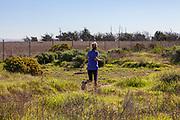 Jogger in Bolsa Chica Ecological Reserve, Orange County, California, USA