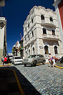 Blue-glazed bricks pave the narrow roads of this section of Old San Juan, Puerto Rico.