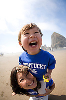 Family playing on Cannon Beach, Oregon.