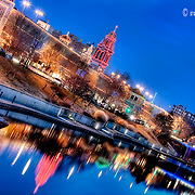 Dusk photo of Kansas City's Plaza Lights with Brush Creek in foreground.