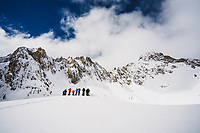 Skiers gather beneath Thompson Peak, Sawtooth Range, Idaho.