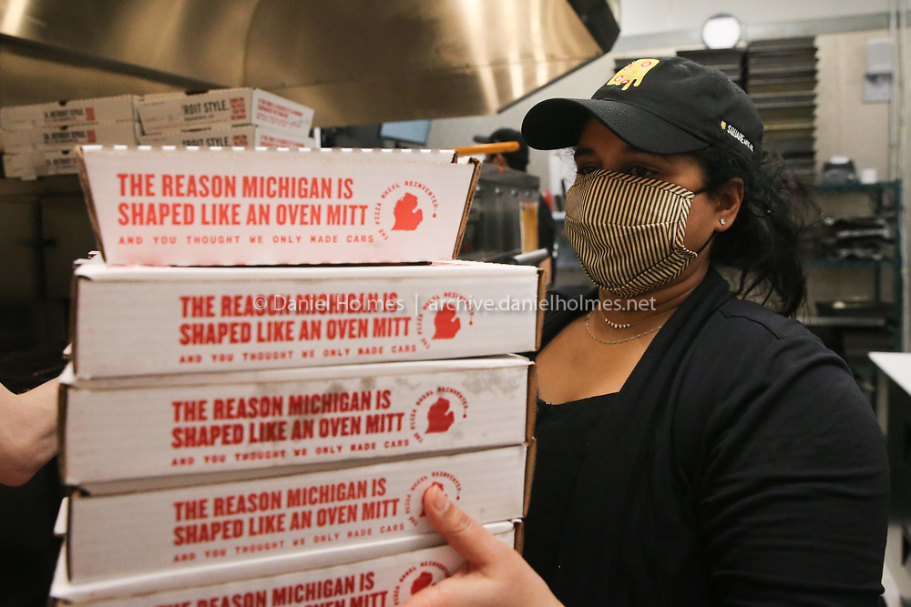 Owner Kris Gullapalli stocks pizza boxes at Square Mfg Co. in Natick on Jan. 05, 2021.