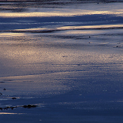 Fort Foster, Kittery, ME. Blue-gray reflections form abstract patterns in the beach.