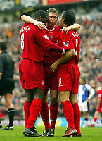 Photo. Aidan Ellis.<br /> Liverpool v Blackburn.<br /> FA Barclaycard Premiership.<br /> 04/04/2004.<br /> Liverpool's harry Kewell and Milan Baros congratulate Emile Heskey on scoring the fourth goal