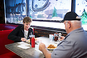 Janice and Roy Brooks enjoy breakfast at McKee's 24 Hour Family Restaurant in Paris, Texas on December 15, 2014. (Cooper Neill for The Texas Tribune)