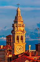The church tower of Santa Maria Formosa Church with the Dolomites behind, Venice, Italy.