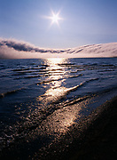 Cloud niagras spilling over Ingitkalik Mountain and onto Krusenstern Lagoon, Cape Krusenstern National Monument, Alaska.