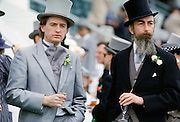 Racegoers drinking champagne in front of the Grandstand at Epsom Racecourse on Derby Day, UK