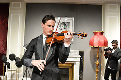 English contemporary classical violinist CHARLIE SIEM at the Dolce & Gabbana London Collections: Mens Event 2014 held at Dolce & Gabbana, 53-55 New Bond Street, London on 5th January 2014.