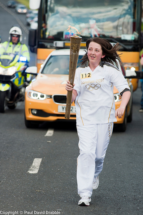 The Olympic Torch relay reaches Sheffield on day 38 coverage from the Chapeltown - Ecclesfield - Parson Cross section of the Journey.<br /> Olympic Torch Bearer 112 Ashley Jeeves aged 14<br /> 25 June 2012.<br /> Image © Paul David Drabble