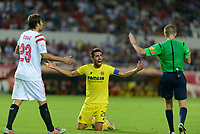 Referee Alejandro J. Henrandez (R) calls for calm to Coke )L) and Bruno (C) during the match between Sevilla FC and Villarreal day 9 spanish  BBVA League 2014-2015 day 5, played at Sanchez Pizjuan stadium in Seville, Spain.(PHOTO: CARLOS BOUZA / BOUZA PRESS / ALTER PHOTOS)