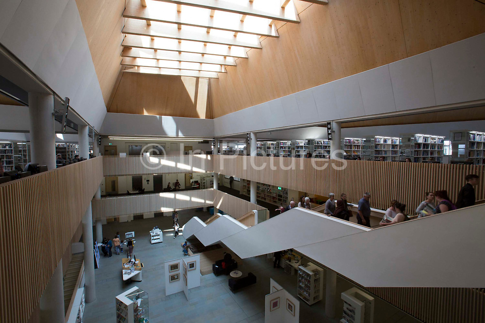 The Central atrium inside The Hive, Worcester, UK. The first fully integrated university and public library in the UK. It also houses the county archives and archaeology service, the local history centre and local authority hub. The building is low energy.
