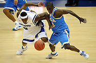 5 APR 2008: Darren Collison (2) of the University of California - Los Angeles and Robert Dozier (2) of the University of Memphis clash during semifinal game of the 2008 NCAA Final Four Division I Men's Basketball championships held at the Alamodome in San Antonio, TX.   Brett Wilhelm/NCAA Photos