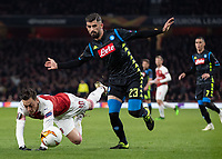 Football - 2018 / 2019 UEFA Europa League - Quarter Final, First Leg Arsenal vs. Napoli <br /> <br /> Mesut Ozil (Arsenal FC) takes a tumble after a challenge from Elseid Hysaj (Napoli) at The Emirates.<br /> <br /> COLORSPORT/DANIEL BEARHAM