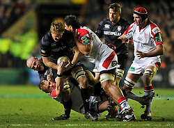 Jamie Gibson (Leicester) is tackled in possession - Photo mandatory by-line: Patrick Khachfe/JMP - Tel: Mobile: 07966 386802 18/01/2014 - SPORT - RUGBY UNION - Welford Road, Leicester - Leicester Tigers v Ulster Rugby - Heineken Cup.