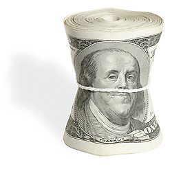 Roll of money with Ben Franklin One hundred dollar bill