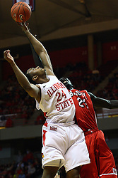 04 February 2012:  Zeke Upshaw and Shayok Shayok reach for a loose ball during an NCAA Missouri Valley Conference mens basketball game where the Bradley Braves lost to the Illinois State Redbirds 78 - 48 in Redbird Arena, Normal IL