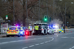 © Licensed to London News Pictures. 16/04/2021. Aylesbury, UK. Vehicles and investigators in front of the police car (far right) that struck a pedestrian, a 25-year-old woman from Aylesbury, on the A41 Bicester Road between Paradise Orchard and Jackson Road in Aylesbury. The pedestrian was struck by the police vehicle at approximately 17:50 BST on Friday 16th April while responding to a separate collision on the same road approximatly 2 miles to the west in Waddesdon. Thames Valley Police has made a mandatory referral to the Independent Office for Police Conduct (IOPC) following the collision. Photo credit: Peter Manning/LNP