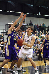 30 December 2006: Andrew Holms forces Brett Chamernik to pull back. The Titans outscored the Britons by a score of 94-80. The Britons of Albion College visited the Illinois Wesleyan Titans at the Shirk Center in Bloomington Illinois.<br />