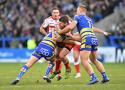 Hull Kingston Rovers' Mitch Garbutt is tackled by Warrington Wolves' Jack Hughes and Daryl Clark during the Betfred Super League match at the Halliwell Jones Stadium, Warrington.