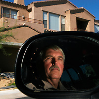 Scottsdale Police officer Tim Finn patrols the Stagecoach Pass neighborhood after a string of break-ins broke out in the normally quiet community, December 3, 2006.