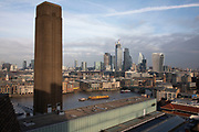 View over the River Thames and the City of London from the Blavatnik Building Viewing Level at Tate Modern art gallery in London, England, United Kingdom. The building, originally Bankside Power Station, was designed by the architect Sir Giles Gilbert Scott. Constructed from a brick shell supported by an interior steel structure, its striking monumental design with its single central chimney, had often led it to be referred to as an industrial cathedral. The 360-degree rooftop viewing deck is one of the headline features of the Switch House – the 64.5-metre-high Tate Modern gallery extension by Herzog & de Meuron, opened to the public in June 2016.