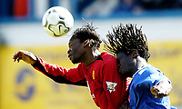 Photo. Richard Lane, Digitalsport..<br /> Portsmouth v Manchester United. FA Barclaycard Premiership. 17/04/2004.<br /> Louis Saha and Linvoy Primus challenge for the ball.