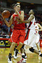 30 December 2010: Kenyatta Shelton gives Mackenzie Westcott a gut check during an NCAA Womens basketball game between the Bradley Braves and the Illinois State Redbirds at Redbird Arena in Normal Illinois.