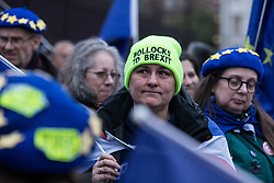 London, UK. 30 January, 2020. A tearful pro-EU activist from SODEM (Stand of Defiance European Movement) attends a party outside Parliament on the eve of Brexit Day on the theme of 'Party like there's no tomorrow'.