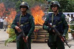 June 26, 2017 - Phnom Penh, Cambodia - Cambodian police officers stand guard as illicit drugs being destroyed in Phnom Penh, Cambodia. Cambodia destroyed 126.31 kg of illicit drugs with a value of about 4 million U.S. dollars on Monday, said Meas Vyrith, secretary-general of the National Authority for Combating Drugs  (Credit Image: © Sovannara/Xinhua via ZUMA Wire)