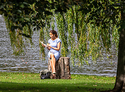 © Licensed to London News Pictures. 07/09/2020. London, UK. After the wind and rain, a women in Hyde Park enjoys some warm weather as a mini heatwave is expected to hit the South East this week with temperatures predicted to reach up to 24c. Photo credit: Alex Lentati/LNP
