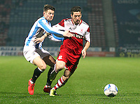 Middlesbrough's Jacob Butterfield holds off the challenge from Huddersfield Town's Oliver Norwood<br /> <br /> Photo by Rich Linley/CameraSport<br /> <br /> Football - The Football League Sky Bet Championship - Huddersfield Town v Middlesbrough - Tuesday 25th March 2014 - The John Smith's Stadium - Huddersfield<br /> <br /> © CameraSport - 43 Linden Ave. Countesthorpe. Leicester. England. LE8 5PG - Tel: +44 (0) 116 277 4147 - admin@camerasport.com - www.camerasport.com