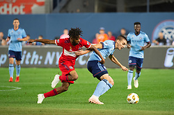 September 26, 2018 - Bronx, New York, US - New York City FC midfielder JAMES SANDS (16) fights for the ball against Chicago Fire midfielder RAHEEM EDWARDS (7) during a regular season match at Yankee Stadium in Bronx, New York.  New York City FC defeats Chicago Fire 2 to 0 (Credit Image: © Mark Smith/ZUMA Wire)