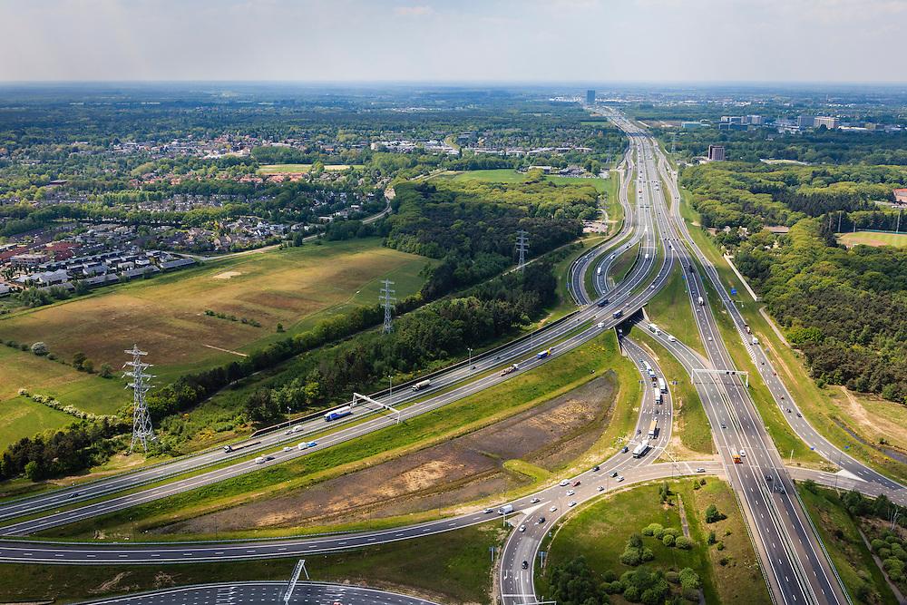 Nederland, Noord-Brabant, Eindhoven, 27-05-2013; Randweg Eindhoven. Knooppunt Leenderheide, verkeersknooppunt van A2 en A67.  Gezien naar het westen, richting Veldhoven. Het oorspronkelijke verkeersplein, met stoplichten, maakt deel uit van het knooppunt.<br /> View on roundabout and traffic junction Leenderheide near Eindhoven, A67 connecting one of the main motorways of the Netherlands A2. <br /> luchtfoto (toeslag op standard tarieven);<br /> aerial photo (additional fee required);<br /> copyright foto/photo Siebe Swart.