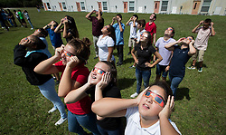 August 21, 2017 - Boynton Beach, Florida, U.S. - (l to r) Christa McAuliffe Middle School seventh-graders Kaylie Mohler, (red shirt) Haley Phillips and Brandy Lasita  watch the partial eclipse with protective glasses provided by the school in Boynton Beach, Florida on August 21, 2017. (Credit Image: © Allen Eyestone/The Palm Beach Post via ZUMA Wire)