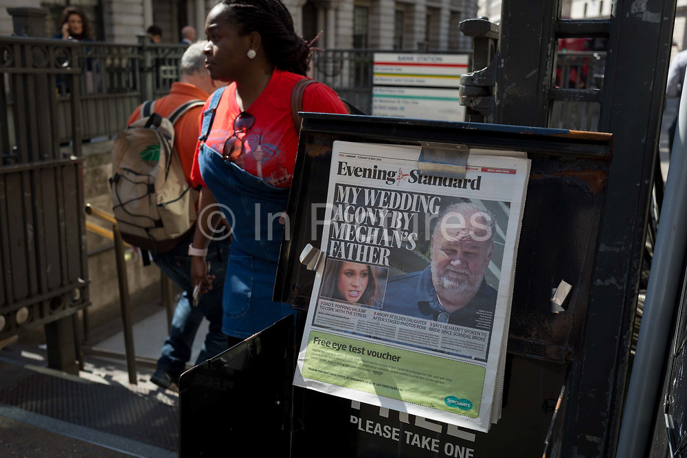 Evening Standard headlines with news of Meghan Markles father not attending the upcoming royal wedding between the American actor and prince Harry, at Bank underground station in the City of London, the capitals financial district aka the Square Mile, on 15th May 2018, in London, UK.