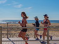 Spring Lake, NJ USA -- May 27, 2017 Female joggers out for a morning run on the boardwalk in Spring Lake.