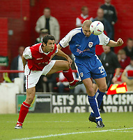 Photo. Andrew Unwin<br /> Rotherham v Millwall, Nationwide League Division One, Millmoor Lane, Rotherham 11/10/2003.<br /> Millwall's Bob Peeters (r) beats Rotherham's Martin McIntosh (l) to the ball.