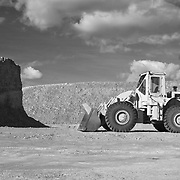 Loader parked in a quarry off of Jackson Highway (16) bakes in the sun.