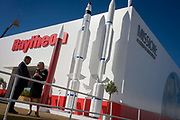 Defence manufacturer Raytheon exhibition stand at the Farnborough Air Show, England. Raytheon Company is a technology and innovation leader specializing in defense, security and civil markets throughout the world. With a history of innovation spanning 92 years, Raytheon provides state-of-the-art electronics, mission systems integration and other capabilities in the areas of sensing; effects; and command, control, communications and intelligence systems.