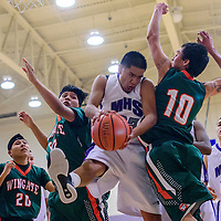 011715       Cable Hoover<br /> <br /> Miyamura Patriot Tyrell Lee (32) fights off Wingate Bears Austin Begay (10) and Brandon Lewis (42) for a rebound Saturday at Miyamura High School.