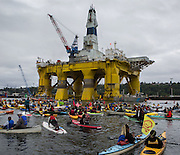 Activists in kayaks protest the Polar Pioneer, Shell's giant oil rig, which was moored at the Port of Seattle's Terminal 5 on May 16, 2015. <br />