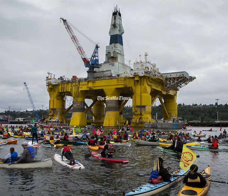 Activists in kayaks protest the Polar Pioneer, Shell's giant oil rig, which was moored at the Port of Seattle's Terminal 5 on May 16, 2015. <br /> Ellen M. Banner / The Seattle Times