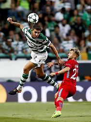 August 15, 2017 - Lisbon, Portugal - Sporting's defender Cristiano Piccini (L) vies for the ball with Steaua's forward Catalin Golofca (R)  during Champions League 2017/18, first playoff round match between Sporting CP vs FC Steaua Bucuresti, in Lisbon, on August 15, 2017. (Credit Image: © Carlos Palma/NurPhoto via ZUMA Press)