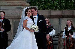 59793568 <br /> The newly wed Swedish Princess Madeleine and U.S. banker Christopher O Neill stand outside the Royal Chapel after their wedding ceremony in Stockholm, Sweden, on June 8, 2013. UK ONLY