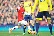 Arsenal's Jack Wilshere looks to break through the Sunderland defence during Barclays Premier League , Arsenal v Sunderland at the Emirates Stadium in London, England on Saturday 22nd Feb 2014.<br /> pic by John Fletcher, Andrew Orchard sports photography.