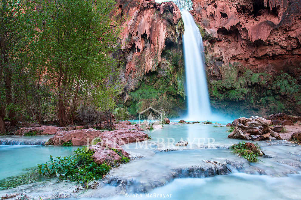 Havasu Falls.  One of my favorite places, located in the Havasupai Reservation along the south rim of the Grand Canyon, these falls are worth the  beautiful 10 mile hike down into the canyon. © John McBrayer
